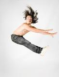 Jumping men. Young men make acrobatic jump Stock Photos
