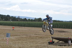 Jumping motocross driver Stock Images