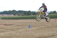 Jumping motocross driver Stock Photo