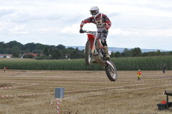 Jumping motocross driver Stock Image
