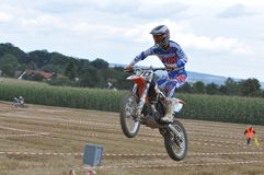 Jumping motocross driver Stock Photography