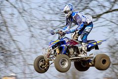 Jumping motocross rider Stock Photo