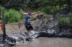 Jumping into mud Royalty Free Stock Photos