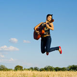 Jumping musician Stock Photo