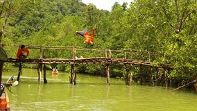Jumping now!!. The boatman jumping show for the tourist Royalty Free Stock Images