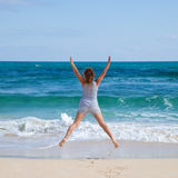 Jumping by an ocean Royalty Free Stock Photography