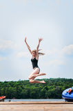 Jumping off a dock Stock Image