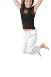 Jumping off the Page. Woman jumps so high she is off the page Stock Image