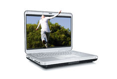 Jumping out from laptop Stock Photos