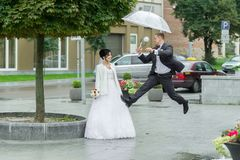 Jumping Out Of Happiness On A Wedding Day. Royalty Free Stock Photos