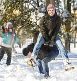 Jumping over another person in wintertime Royalty Free Stock Image