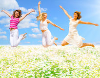 Jumping over flower field Stock Images