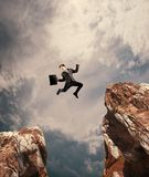 Jumping over a gap business stock photography