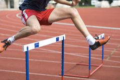 Jumping over the hurdle Stock Images