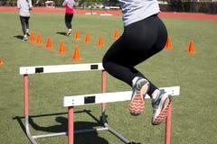 Jumping over hurdles Royalty Free Stock Photos