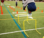 Jumping over hurdles at Speed practice Royalty Free Stock Photos