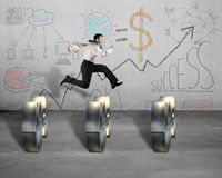 Jumping over money symbol with business doodles on wall Royalty Free Stock Images