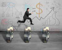 Jumping over money symobol with business doodles on wall Stock Photo