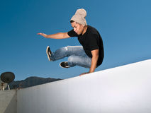 Jumping over a wall Royalty Free Stock Photo