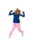Jumping in pajamas Royalty Free Stock Photos