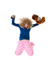 Jumping in pajamas Stock Photography