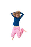 Jumping in pajamas Royalty Free Stock Image