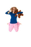 Jumping in pajamas Royalty Free Stock Images