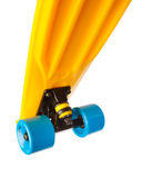 Jumping penny skateboard, bottom view on white Royalty Free Stock Images