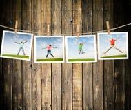 Jumping people. On idyllic landscape Stock Photos