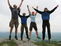Jumping people. Four jumping people in mountain Stock Photography