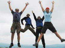 Jumping people. Four happiness jumping people on park Stock Photo