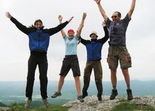 Jumping people. Four jumping people in mountain Stock Photos