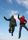Jumping people. Two jumping people on blue background Stock Image
