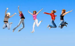 Jumping people. Are happy people on sky background Royalty Free Stock Photography
