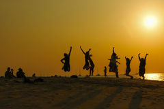 Jumping People on the beach. Group of people was jumping for taking a photo on the beach in south of Thailand Royalty Free Stock Image
