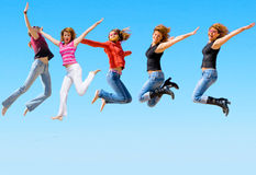 Jumping people are happy people Stock Photography