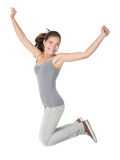 Jumping People Isolated: Student woman jump. Jumping people isolated on white background: casual woman jumping happy and free in full body. Beautiful Caucasian Stock Image