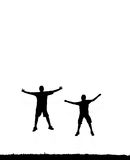 Jumping people silhouette. Two people jumping high in the air silhouettes with copy space Royalty Free Stock Photo