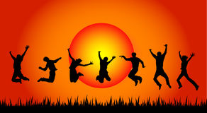 Jumping people in sunset Stock Photography
