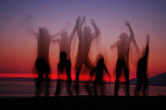 Jumping people in sunset. Jumping people silhouettes in sunset, albanian beach Stock Images