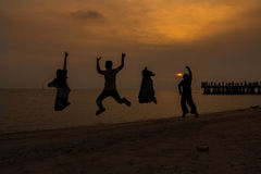 Jumping people on sunset time. Peace and jumping people on sunset time Stock Photography