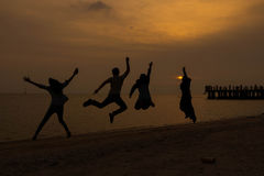 Jumping people on sunset time. Peace and jumping people on sunset time Royalty Free Stock Images