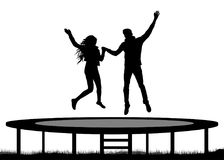 Jumping people on a trampoline silhouette, jump young couple.  Royalty Free Stock Photos