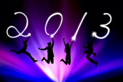 Jumping people writing 2013. Stock Image