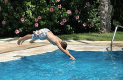 Jumping in the pool Royalty Free Stock Image