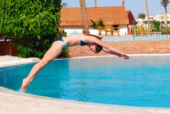 Jumping into the pool Stock Photography