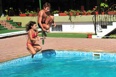 Jumping in pool Stock Image