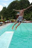 Jumping in the pool. Man jumping in the pool located at Pangkep Indonesia royalty free stock photography
