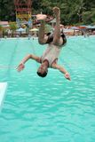 Jumping in the pool. Man jumping in the pool located at Pangkep Indonesia stock photos