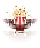 Jumping popcorn and film-strip film Stock Images